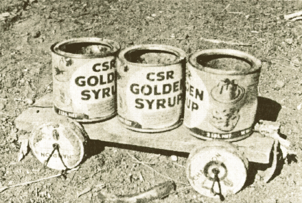 A child's pull along toy made from tobacco tins and golden syrup tins ca 1959 (published in Australian Archaeology 53:28).